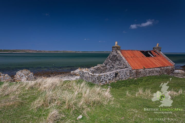 """on the eastern side of Loch Gruinart, stands a beautiful deserted cottage with a lovely red tin roof called """"Crois Mhor"""" which was used by the sheep as a shelter."""
